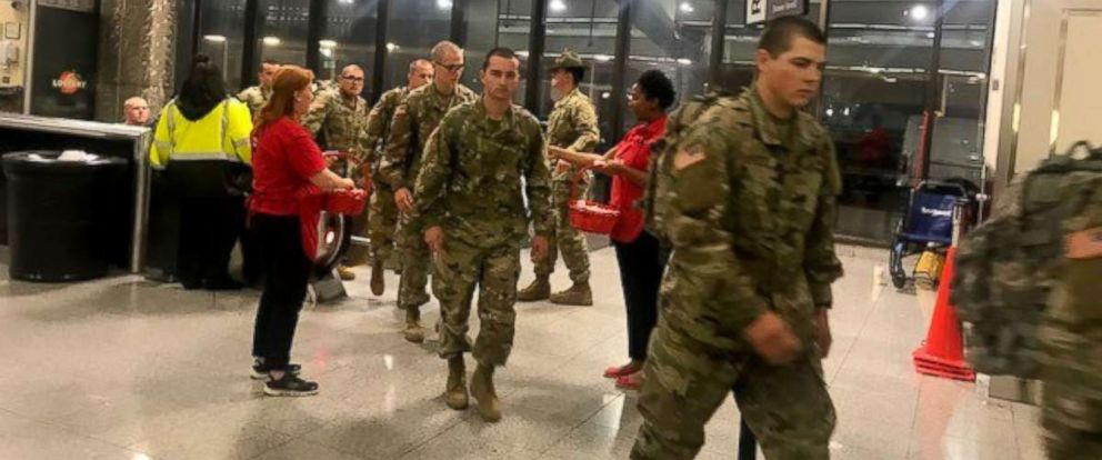 PHOTO: USO Volunteers greet the thousands of Army recruits from Fort Benning, Georgia who arrived at Atlantas Hartsfield-Jackson International Airport to begin a weeks leave for the holiday season.