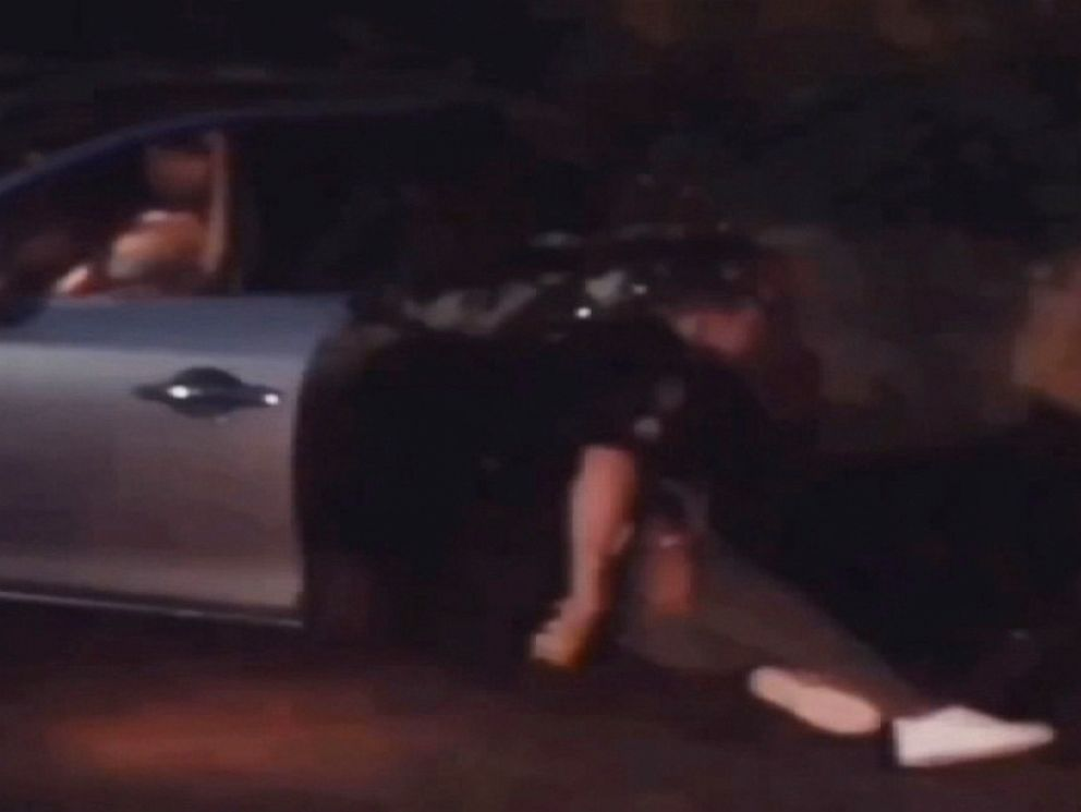 PHOTO: A cell phone video taken May 1, 2019, shows an Atlanta Police officer allegedly pulling Maggie Thomas from her car, slamming her to the ground and using a stun gun on her.