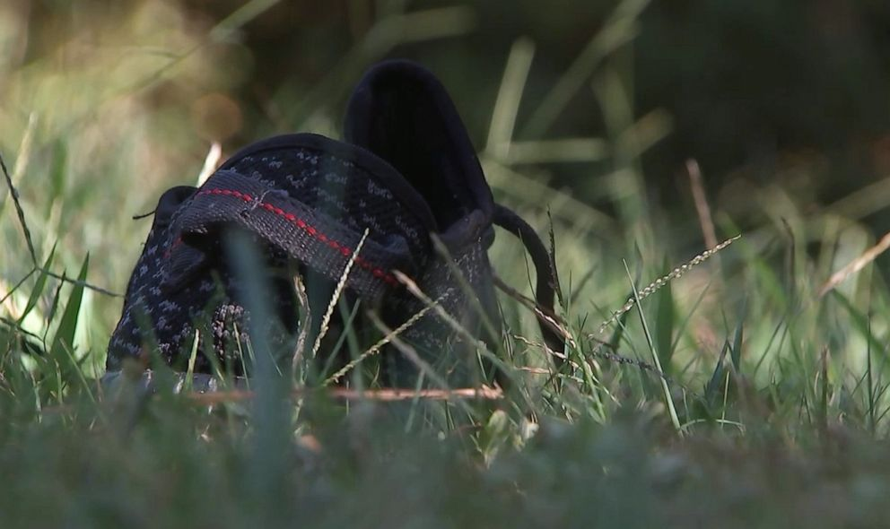 PHOTO: A lost shoe is pictured outside the scene where a homeowner shot and killed three men who were wearing masks early Monday morning on Sept. 16, 2019, in Rockdale County, Ga.