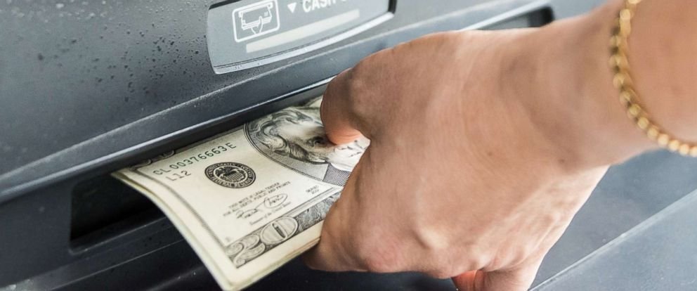 PHOTO: A woman takes money from an ATM in an undated stock photo.