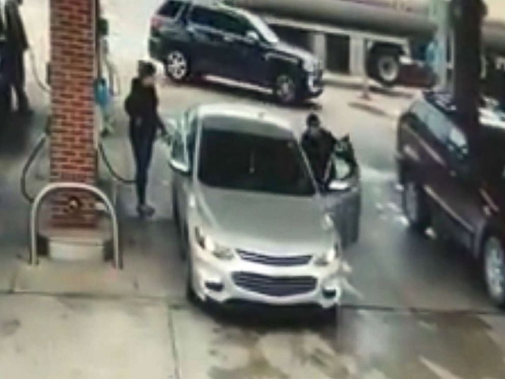 PHOTO: Surveillance video shows an unidentified man jumping into a womans car at a gas station in Allen Park, Mich., Oct. 12, 2017.