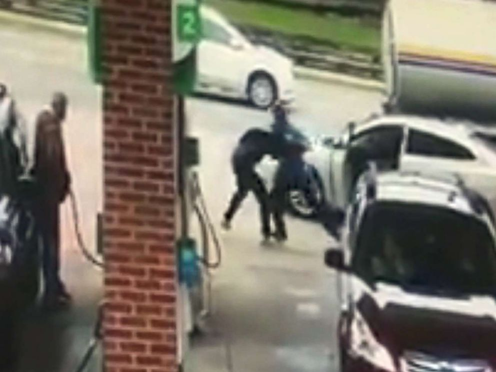 PHOTO: Surveillance footage shows a bystander struggling with an unidentified man who attempted to steal a womans car in broad daylight at a gas station in Allen Park, Mich., Oct. 12, 2017.