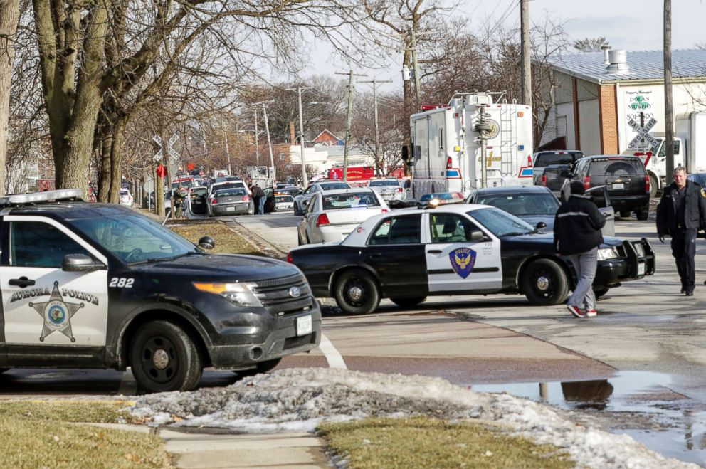 PHOTO: Law enforcement personnel gather near the scene of a shooting at an industrial park in Aurora, Ill., Feb. 15, 2019.