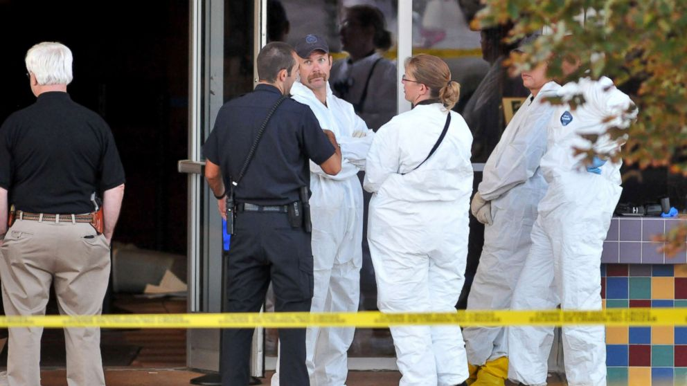 "Investigators are on the scene at the Century 16 movie theatre where a gunmen attacked movie goers during an early morning screening of ""The Dark Knight Rises,"" July 20, 2012, in Aurora, Colorado."