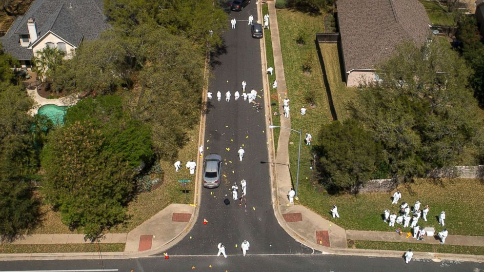 Investigators work at the scene of a bomb explosion on Dawn Song Drive in Austin, Texas, March 19, 2018.
