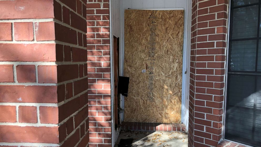 The doorway of a home where a fatal parcel bomb exploded on March 2, 2018 is seen boarded-up in Austin, Texas, March 12, 2018.