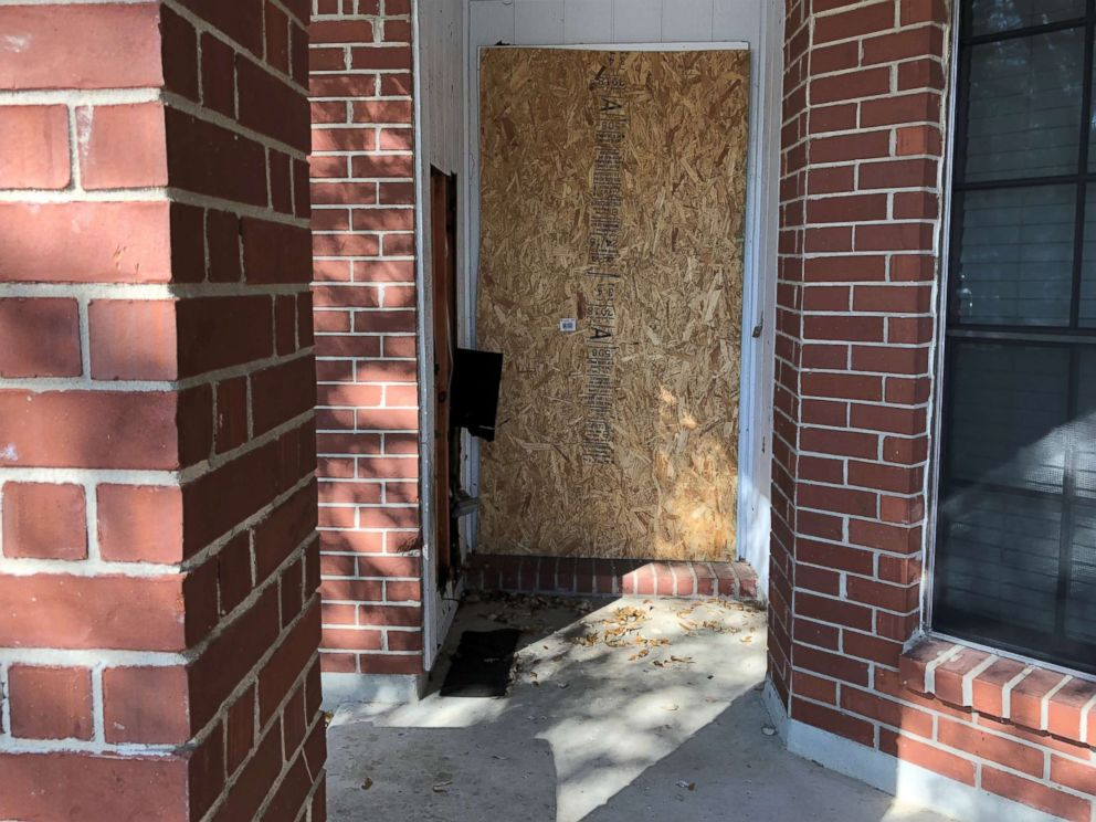 PHOTO: The doorway of a home where a fatal parcel bomb exploded on March 2, 2018 is seen boarded-up in Austin, Texas, March 12, 2018.