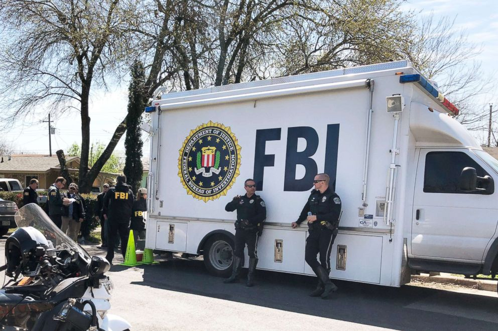 PHOTO: Law enforcement personnel including FBI agents are seen near a home where a parcel bomb exploded in Austin, Texas. Authorities are continuing their investigation, March 13, 2018.