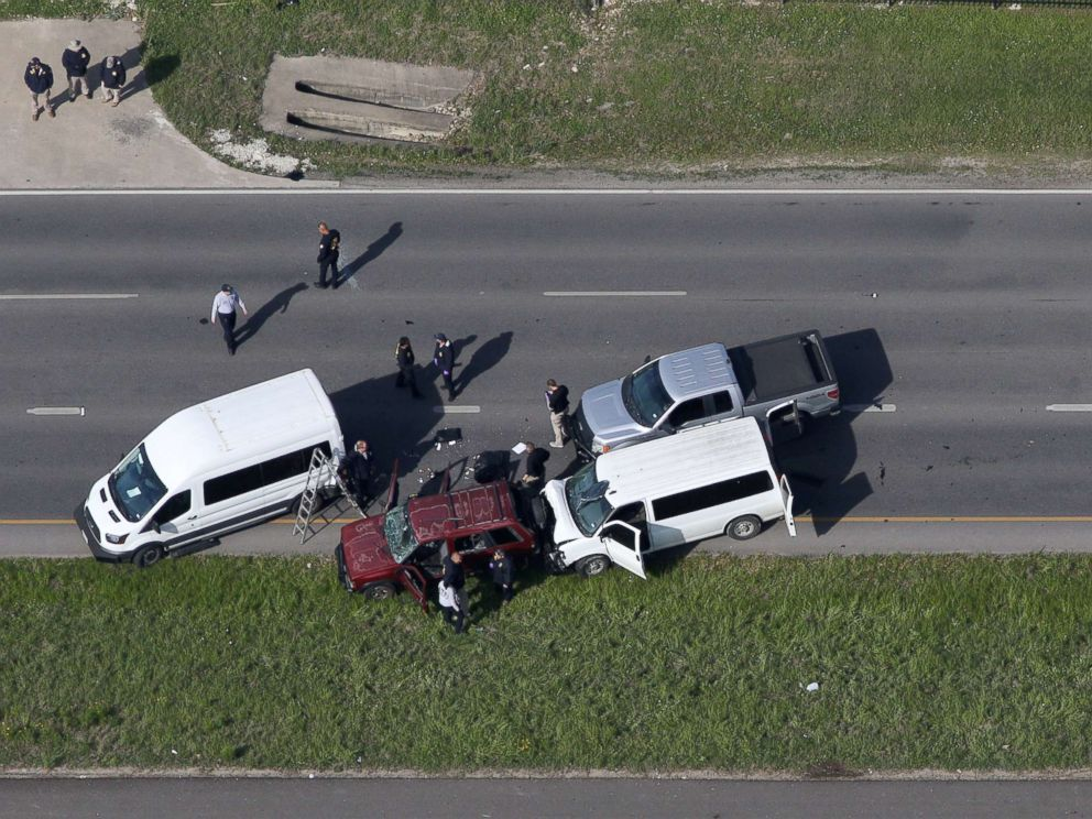 PHOTO: Law enforcement personnel investigate the scene where the Texas bombing suspect blew himself up on the side of a highway north of Austin in Round Rock, Texas, March 21, 2018.