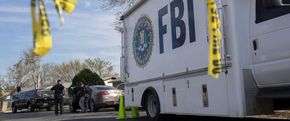 PHOTO: An FBI vehicle is parked on a street where a package bomb exploded the day before, in Austin, Texas, March 13, 2018. In the span of 10 days in Austin, two people have been killed.