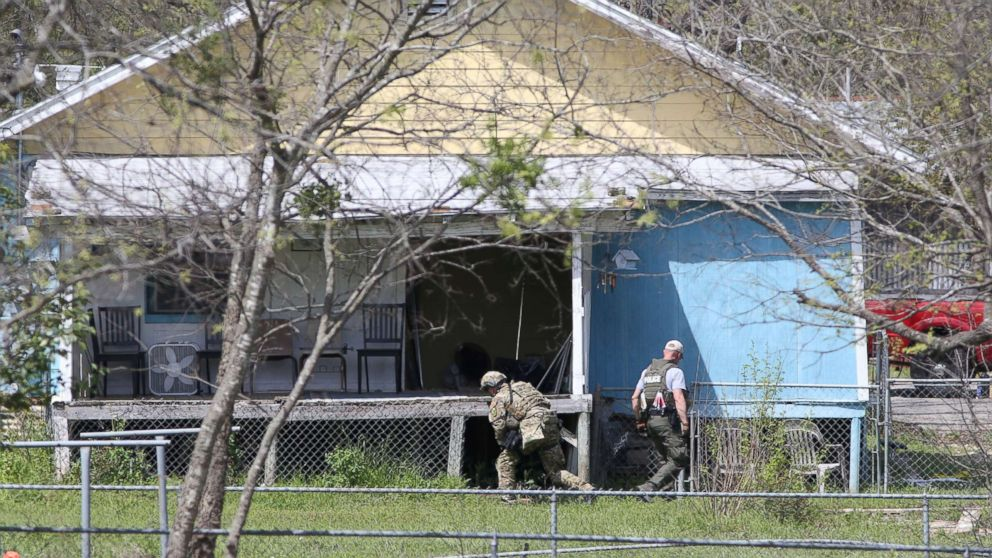 Law enforcement personnel investigate a home where the bomber was suspected to have lived in Pflugerville, Texas, March 21, 2018.