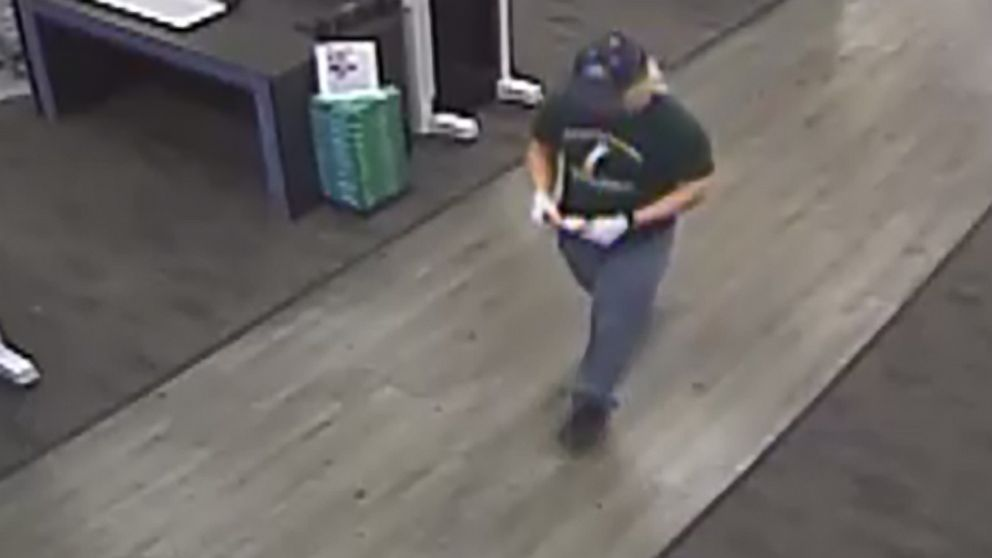 An image made from security camera footage appears to show a man identified by authorities as Austin bombing suspect Mark Conditt shipping two packages at a FedEx store on March 18, 2018.