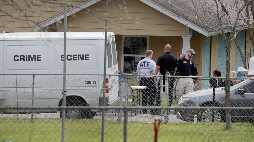 Law enforcement officials continue their investigation at the home of Mark Anthony Conditt, March 22, 2018, in Pflugerville, Texas.