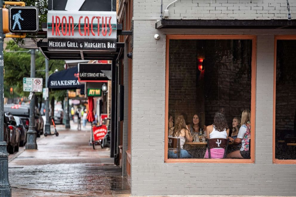 PHOTO: People have lunch at a restaurant in Austin, Texas, June 26, 2020.