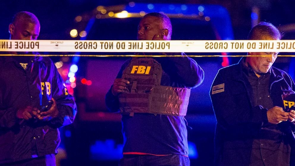 FBI agents work the scene of an explosion in Austin, Texas, Sunday, March 18, 2018. At least a few people were injured in another explosion in Texas' capital late Sunday, after three package bombs detonated this month in other parts of the city, killing two people and injuring two others.