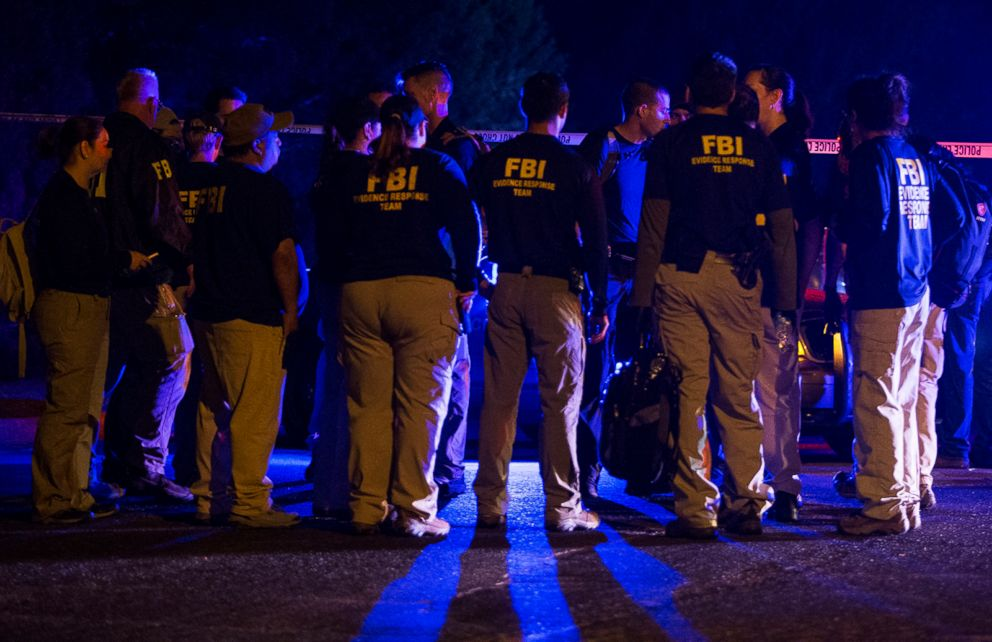 PHOTO: FBI agents meet at the scene of an explosion in Austin, Texas, Sunday, March 18, 2018.