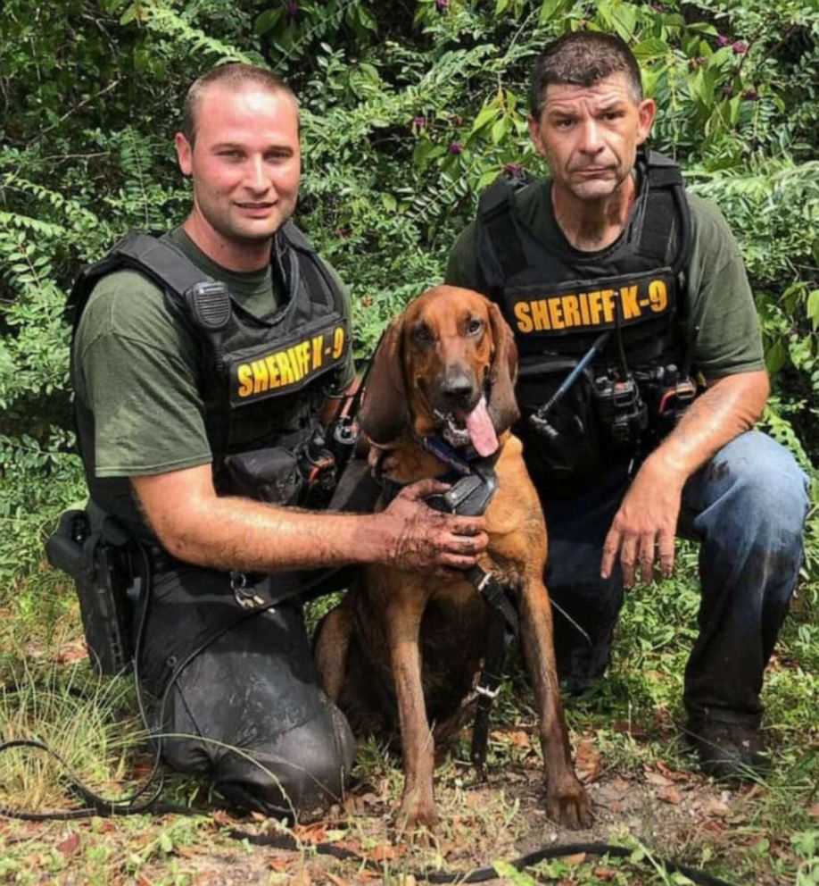 PHOTO: Officers posing with blood hound.
