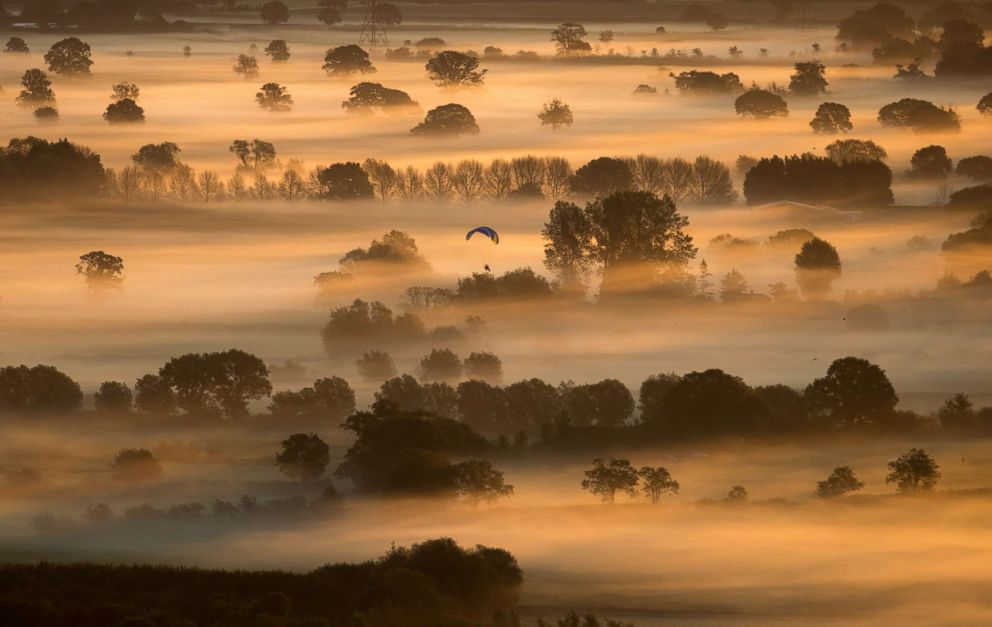 PHOTO: Early morning mist lingers in fields as the autumn sun rises over the Somerset Levels on the Autumn Equinox near Glastonbury, Sept. 22, 2017, in Somerset, England.