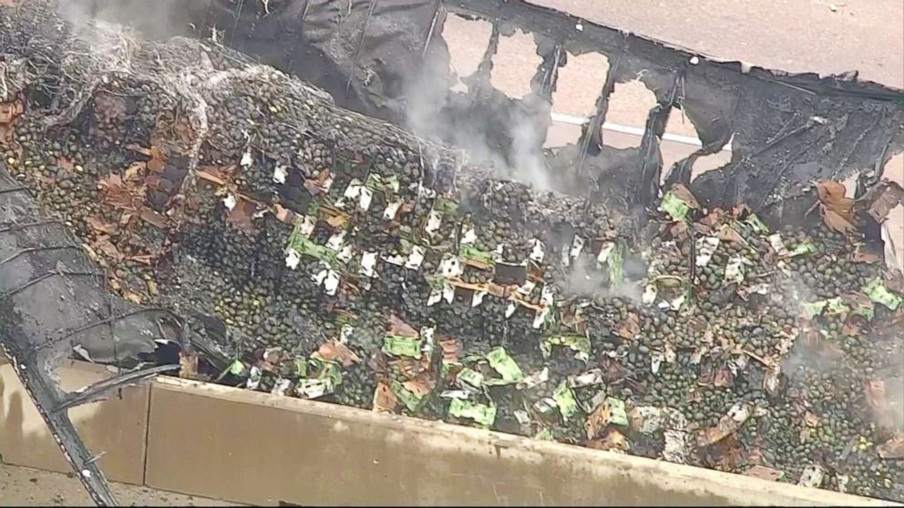 PHOTO: Avocados lie at the scene where a 18-wheeler spilled about 40,000 pounds of avocados after crashing and catching fire, Dec. 12, 2017.