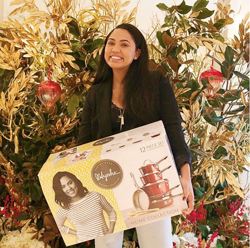 PHOTO: Ayesha Curry poses with her cookware set.