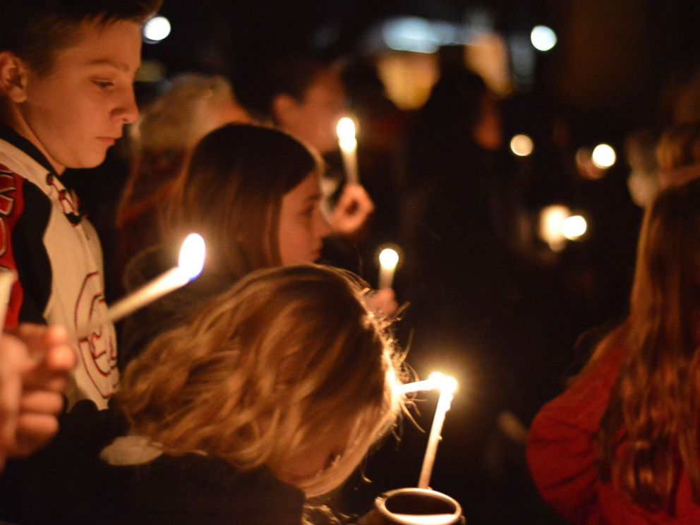 PHOTO: Aztec High School students and area residents gather for a candlelight vigil in Aztec, N.M., Dec. 7, 2017, after a shooting at the high school.