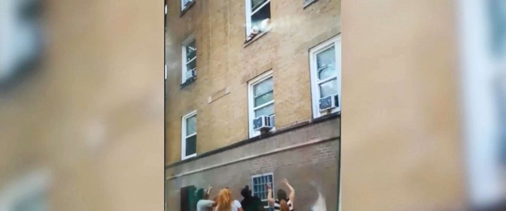 PHOTO: Good Samaritans came together in Chicago to save two toddlers hanging outside a window, July 10, 2018.