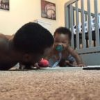 In a viral video posted to Instagram, baby Landon Todd is seen mimicking his dad, Charlie Todd, of Greenwood, Indiana, doing push-ups.