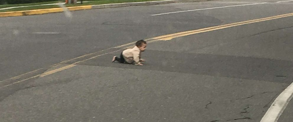 PHOTO: A baby crawls across Joe Parker Road in Lakewood Township, N.J., in a photo taken by a passing motorist who stopped to move the child off of the street.