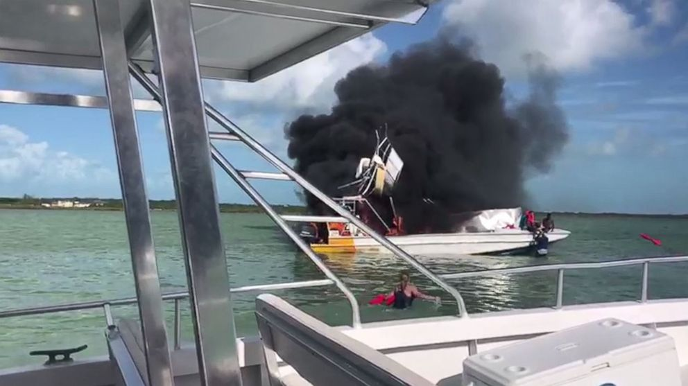 People on a neighboring boat attempted to rescue injured passengers from the explosion off Exuma in the Bahamas on Saturday, June 30, 2018.