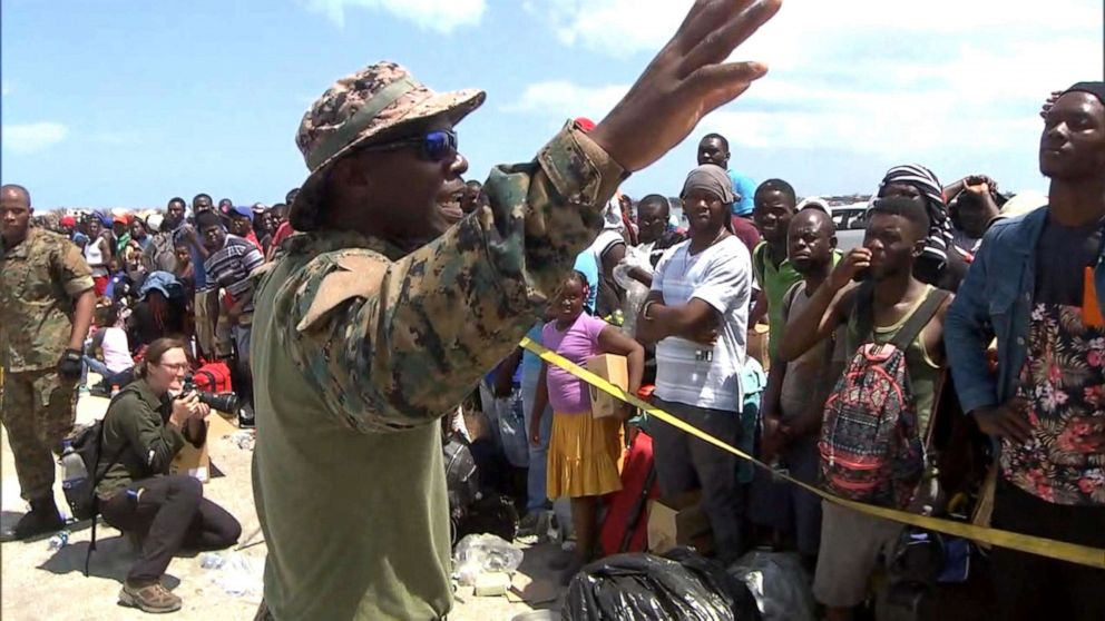PHOTO: Senior Lt. William Sturrup of the Royal Bahamian Defense Force tells desperate evacuees to be patient as they wait to leave the Abaco Islands after they were hit by Hurricane Dorian.