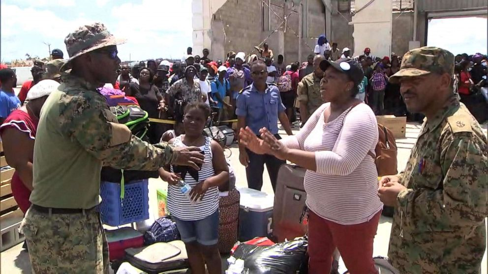 PHOTO: Rymrih Nairn, a mother of three, pleads with military officials for help in getting evacuated from the Abaco Islands in the Bahamas.