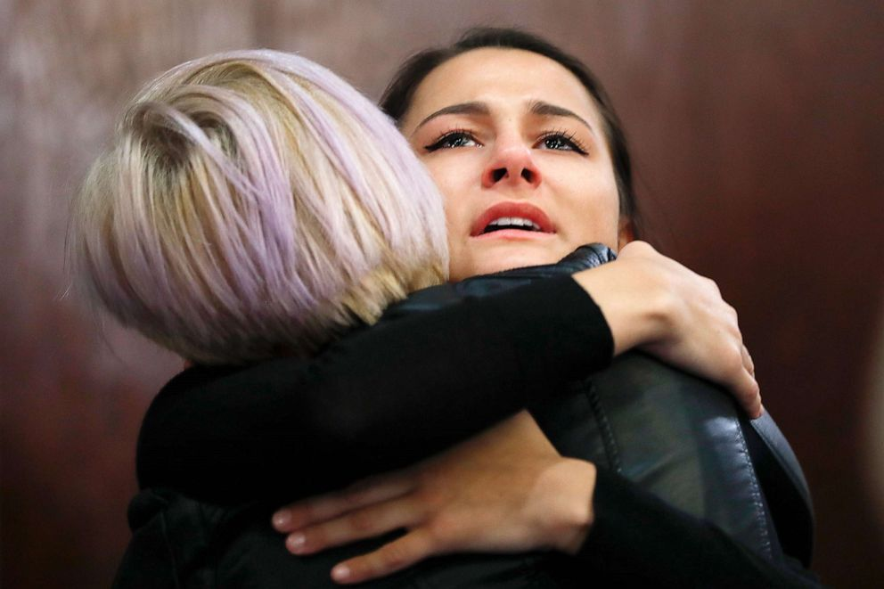 PHOTO: Bailey Kowalski hugs a friend after a news conference in East Lansing, Mich., Thursday, April 11, 2019.