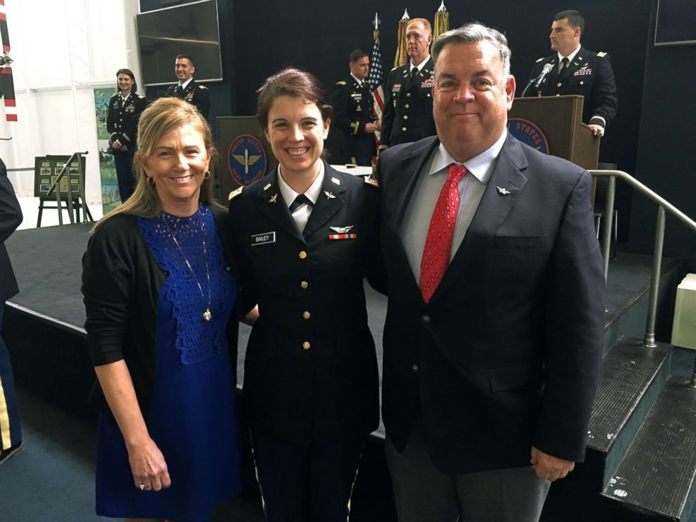 PHOTO: Army 1st Lt. Kathryn Bailey with her parents, Virginia Koch and Thomas Bailey, at her graduation from flight school at Fort Rucker, March 2017.