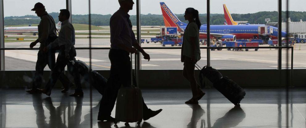 PHOTO: Passengers move through the terminal at Baltimore/Washington International Thurgood Marshall Airport, June 22, 2017 in Baltimore, Md.