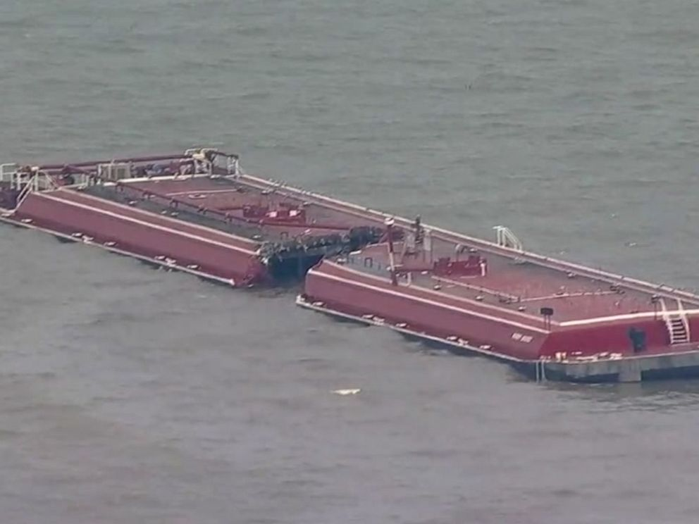 PHOTO: One barge carrying reformate, a gasoline product, capsized and another was nearly sliced in half in a collision with an oil tanker near Houston on Friday, May 10, 2019.