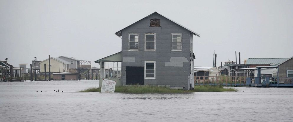 PHOTO: Water recedes from around fish camps that make up the village following Hurricane Barry, July 14, 2019, in Wilkerson Bayou, La.