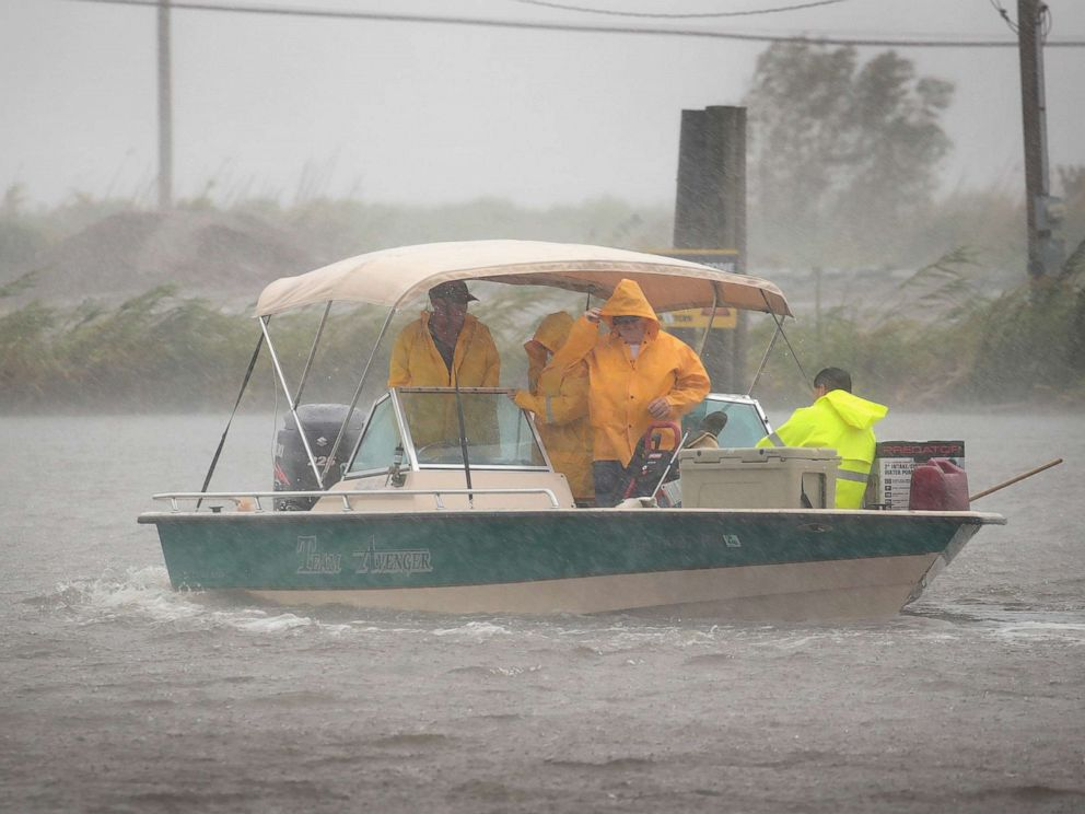 PHOTO: Boaters head out in a driving rain to survey damage to their fish camps in the wake of Hurricane Barry, July 14, 2019, in Myrtle Grove, La.