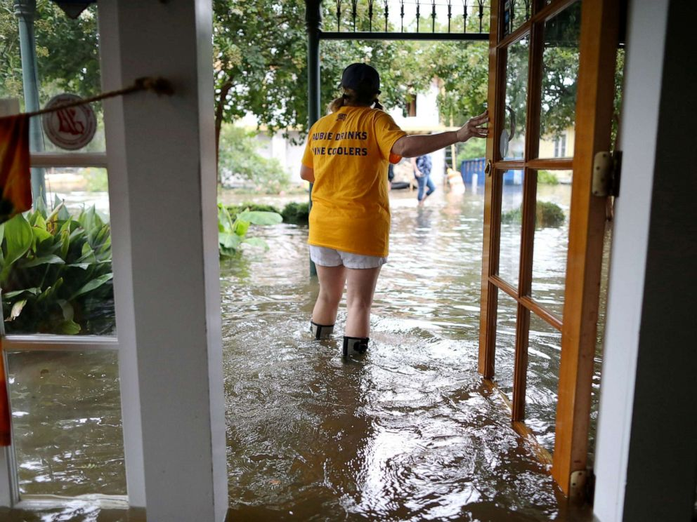 PHOTO: Robyn Iacona-Hilbert stands outside her flooded business after Hurricane Barry came ashore in Mandeville, La., on Saturday, July 13, 2019.
