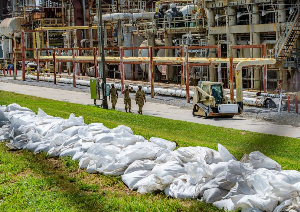 PHOTO: Soldiers with the U.S. Army National Guard work on adding sandbags to levees by the Chalmette Refining plant in Chalmette, La., July 11, 2019, ahead of Tropical Storm Barry.