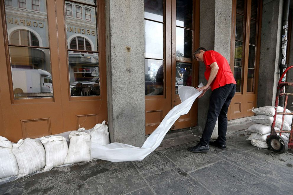 PHOTO: An employee places sandbags in front of a business in the French Quarter as Tropical Storm Barry approaches land in New Orleans, Louisiana, July 12, 2019.