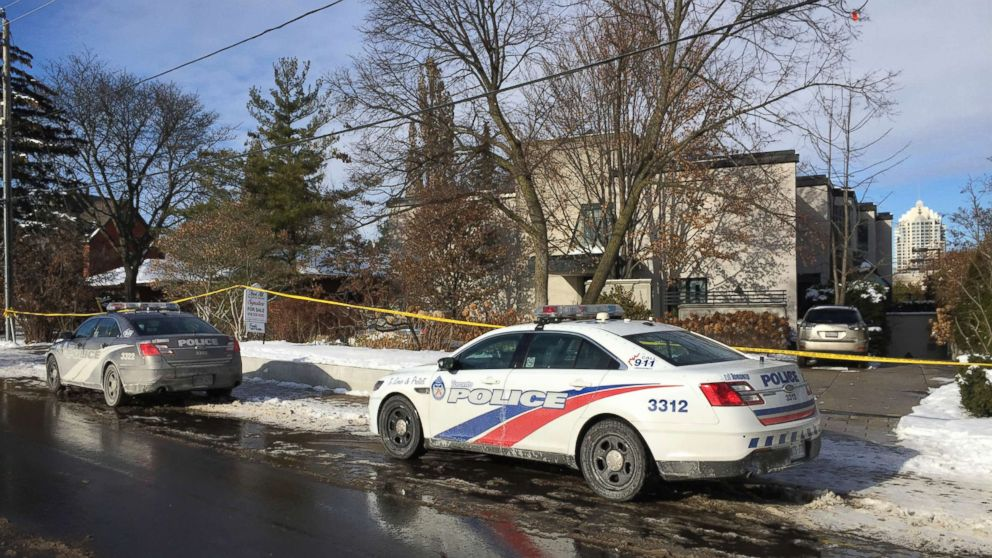 Police cars are parked outside the home of billionaire Barry Sherman, Dec. 17, 2017 in Toronto.