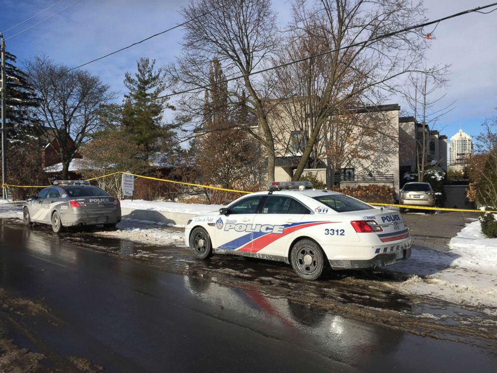 PHOTO: Police cars are parked outside the home of billionaire Barry Sherman, Dec. 17, 2017 in Toronto.