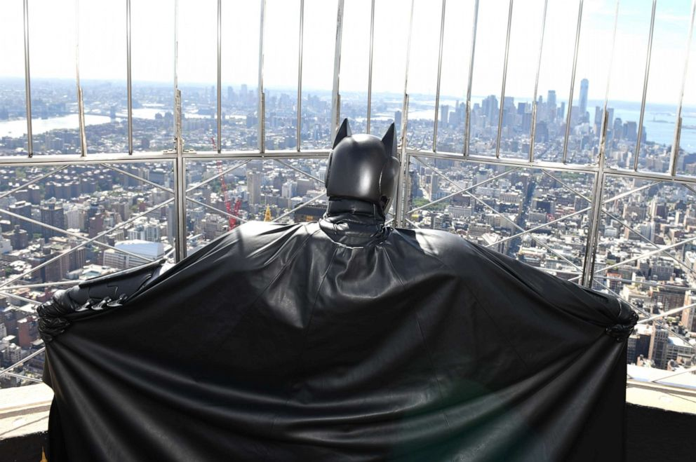 PHOTO: Batman celebrated his 80th birthday by visiting Gothams most iconic sky scraper, the Empire State Building with Dan DiDio, Executive Vice President and Publisher of DC Comics at The Empire State Building on September 20, 2019 in New York City.