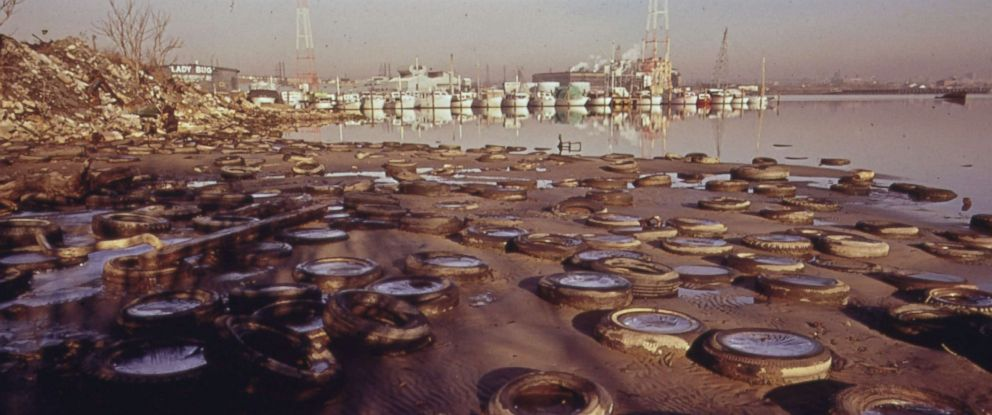 PHOTO: Trash and old tires litter the shore of the harbor in Baltimore, Md., in January 1973.