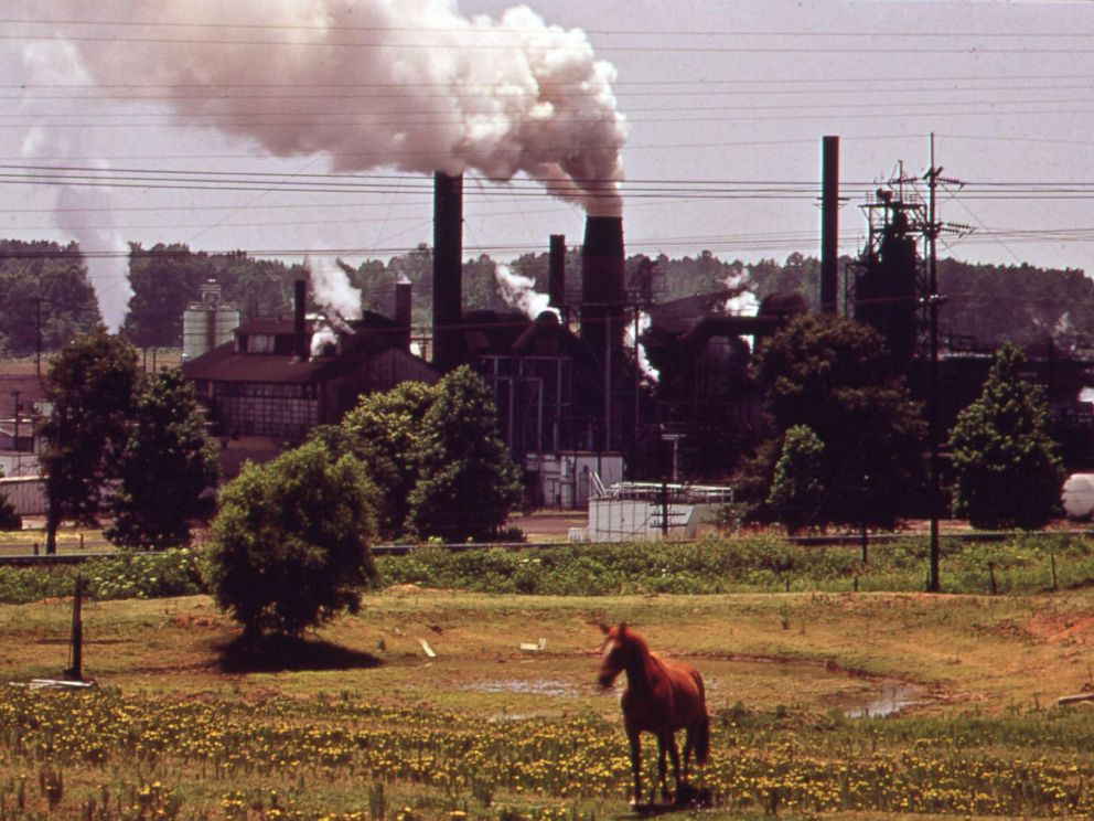 PHOTO: An Atlas Chemical Company plant, referred to as Old Darky because of the black soot that it emits, belches smoke across pasture land near Marshall, Texas, in 1972.