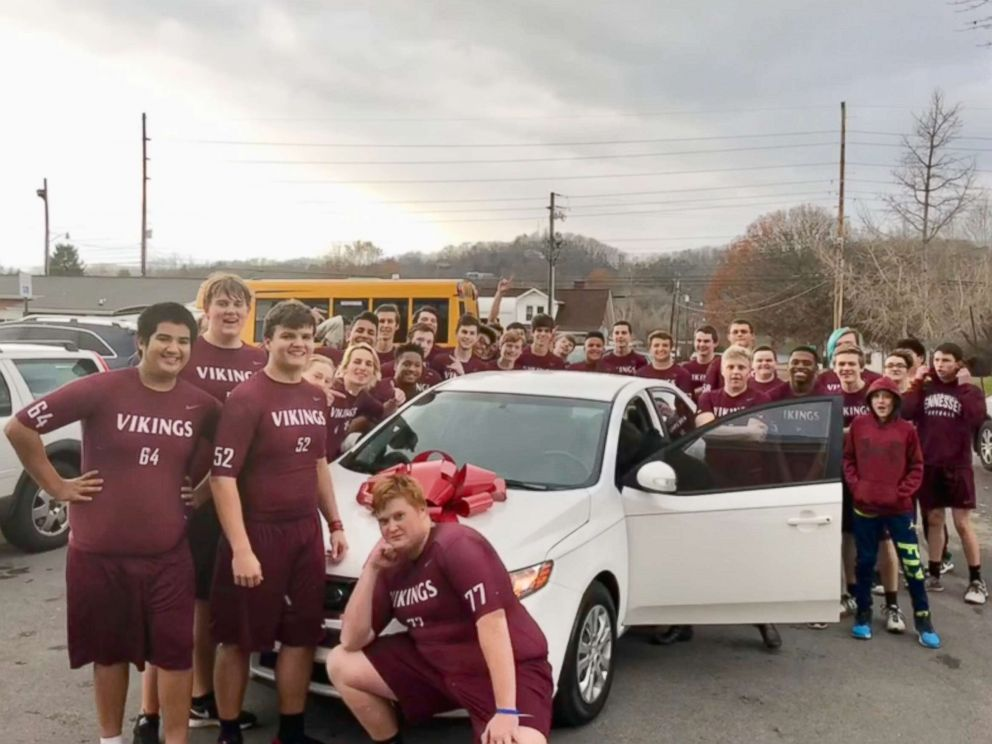 PHOTO: Narcellus Squeaky Black, in his new car surrounded by the football, team and school community that helped raise money for it. He does the laundry for the team, sets up the food and is present at every game. And, Black does it all for free.