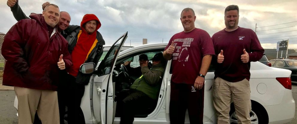 """PHOTO: The Tennessee High School community in Bristol helped raise money to buy volunteer coach Narcellus """"Squeaky"""" Black a new car and a years worth of insurance. They presented it to him Dec. 12."""