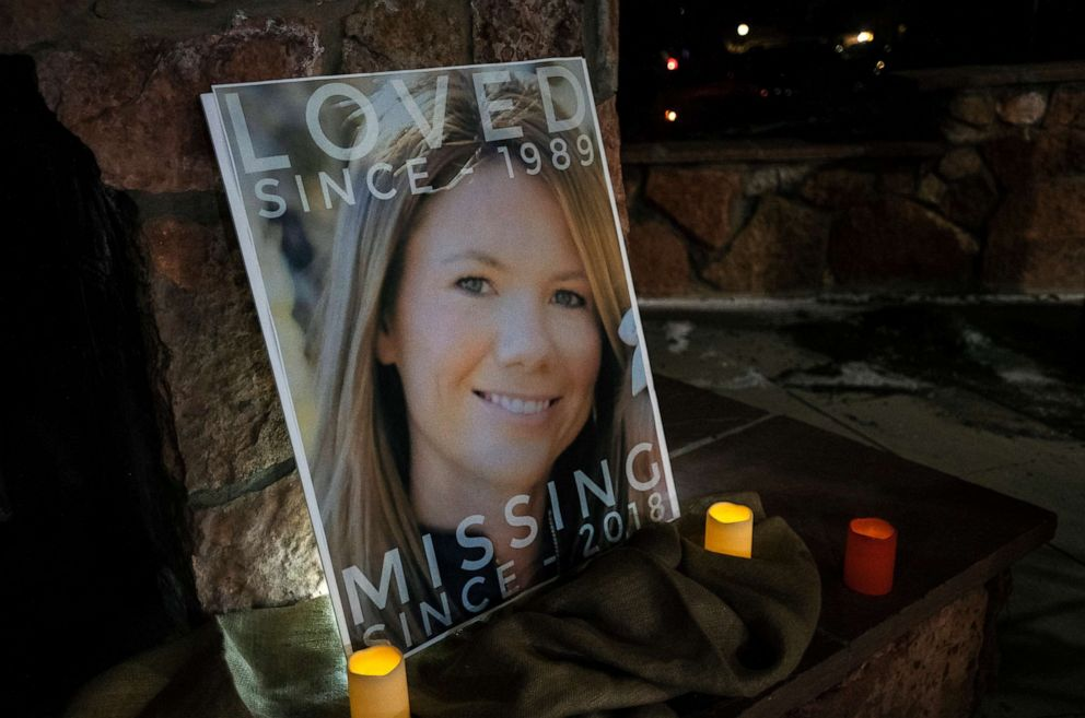 PHOTO: In this Dec. 13, 2018 file photo, a poster with the picture of missing Kelsey Berreth is propped up with candles for a vigil at Memorial Park in Woodland Park, Colo.