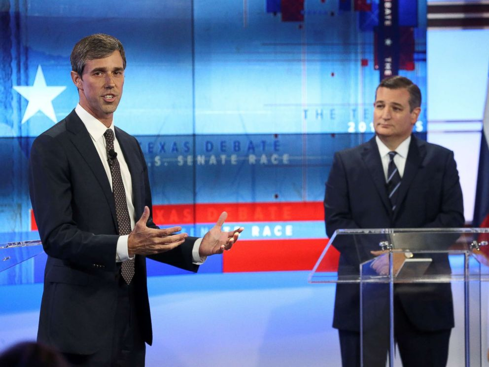 PHOTO: Rep. Beto ORourke speaks as Senator Ted Cruz looks on, during a debate in San Antonio, Texas, Oct. 16, 2018.
