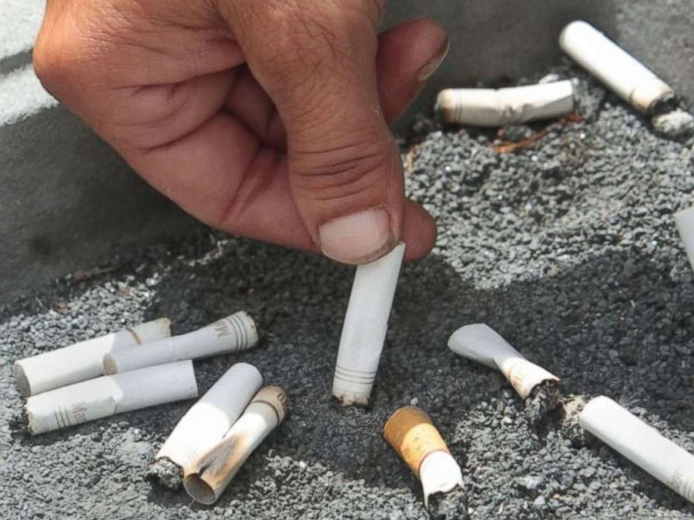 PHOTO: A smoker snuffs out a cigarette at the Capitol in Sacramento, Calif., June 22, 2012.